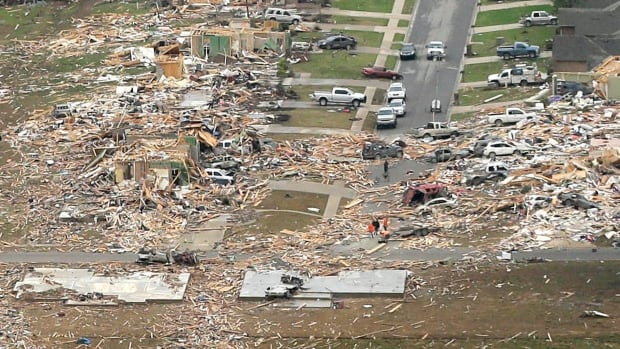 A neighbourhood in Vilonia, Ark., was reduced to rubble after a tornado struck late Sunday. The most powerful twister this year carved an 130-km path of destruction through suburbs north of the state capital of Little Rock.