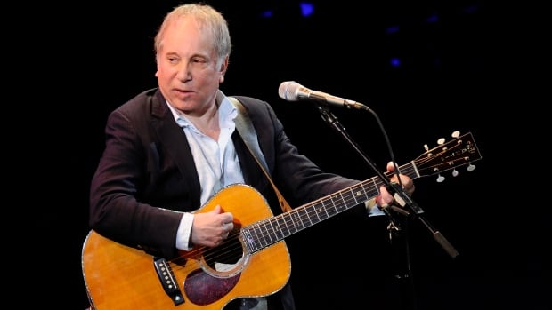 Paul Simon, seen performing in New York in 2012, and his wife, singer Edie Brickell, have been arrested on disorderly conduct charges.