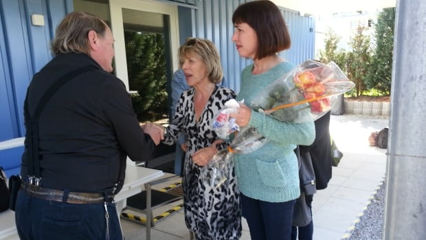 Susan Griffiths (centre) and her daughter Natasha Griffiths (right) are greeted at Dignitas in April 2013.