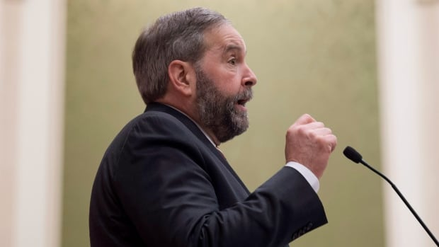 NDP Leader Tom Mulcair says pressure from his party forced the Conservatives to back down on their changes to the Elections Act - and now he wants to see the details of amendments to the bill, C-23.