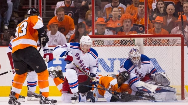 New York defenceman Ryan McDonagh gets low to provide an obstacle in front of teammate Henrik Lundqvist in a previous series game in Philadelphia.