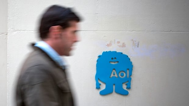 "A man walks past the AOL logo at the company's office in New York last November. AOL said Monday that the private information of a ""significant number"" of its email users' accounts may have been exposed."