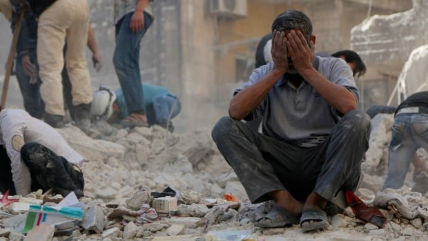 A man reacts in the aftermath of a reported attack by forces loyal to Syria's President Bashar al-Assad last weekend. SANA blamed an attack in central Damascus Tuesday on terrorists — a term used by Assad's government for rebels fighting to oust him.
