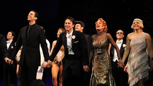 """Hamilton Actor Nick Cordero, left, Zach Braff, Marin Mazzie and Betsy Wolfe on stage during the curtain call for the opening night of """"Bullets Over Broadway"""" at the St James Theatre on Thursday, April 10, 2014 in New York."""