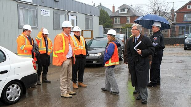 Local politicians and police get ready for a tour of the new Tim Horton's Field.