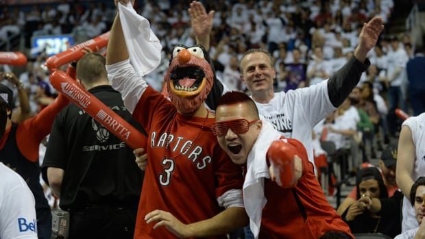 Diehard fans cheer on the Toronto Raptors in their playoff series against the Brooklyn Nets at Air Canada Centre on April 22.
