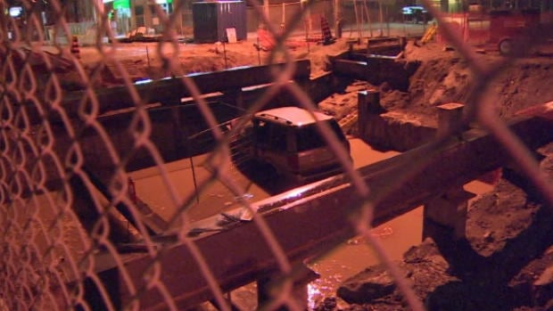 A woman escaped injury early Wednesday after driving her SUV into a LRT construction put on Eglinton Avenue West.