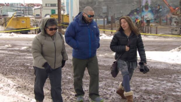Colin Makpah, in blue, heads to the Iqaluit courthouse where he's facing a charge of manslaughter in the death of Donald Gamble in Rankin Inlet in August of 2010. Makpah has pleaded not guilty.