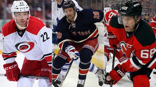 Jaromir Jagr of the New Jersey Devils, Manny Malhotra, left, Dominic Moore, centre, and Jaromir Jagr are vying for the NHL's Masterton Memorial Trophy.