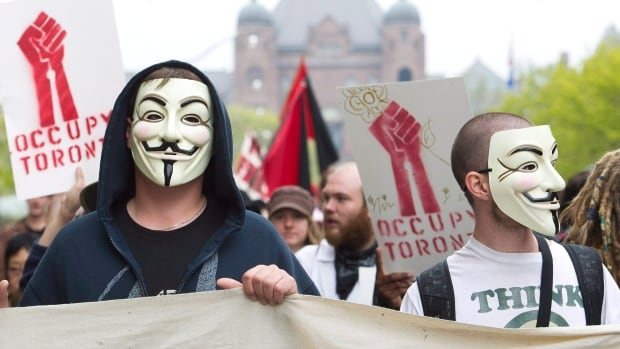 Occupy Toronto protesters in support of May Day walk the streets in downtown Toronto on Tuesday, May 1, 2012. An OECD study confirms the one per cent is getting the lion's share of income growth.