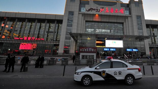 Security personnel gather near the scene of an explosion outside the Urumqi South Railway Station in northwest China's Xinjiang region on Wednesday. An explosion shook the railway station, injuring many people as President Xi Jinping wrapped up a four-day visit to the area, state media said Wednesday.