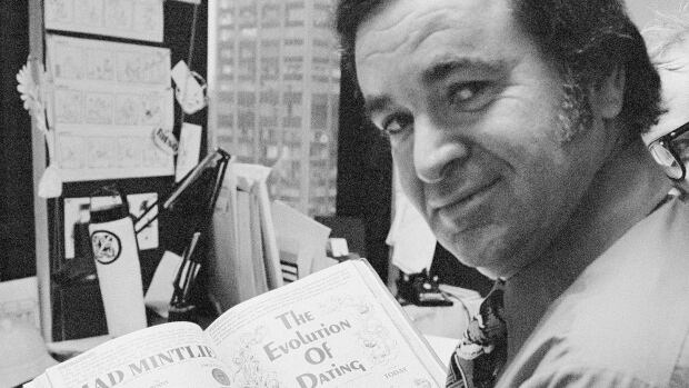 Former Mad editor Al Feldstein is seen working on a page layout at the satirical magazine's New York headquarters in 1972. During his 28 years at the helm of Mad, he transformed the satirical magazine into a pop culture institution.