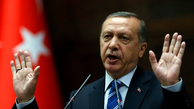 Turkey's Prime Minister Recep Tayyip Erdogan addresses members of parliament from his ruling AK Party (AKP) during a meeting at the Turkish parliament in Ankara on Tuesday. Experts say Turkey is keeping its distance from the Ukraine crisis due to its economic relationship with Russia.