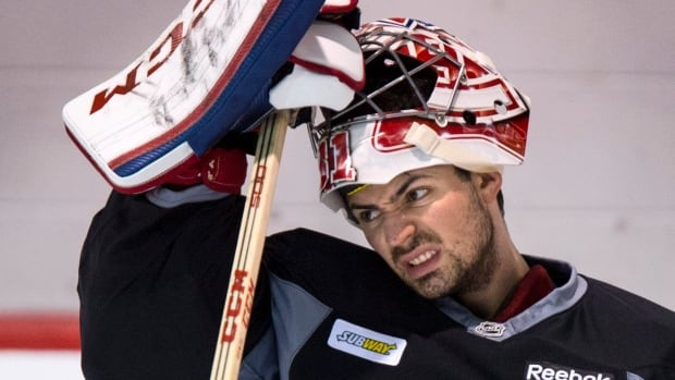 Montreal Canadiens goalie Carey Price slips on his face mask during a practice Wednesday in Brossard, Que., a day before the second round begins for the club.