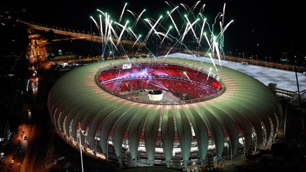 An aerial view shows fireworks over the Beira-Rio stadium during its opening ceremony in Porto Alegre April 5, 2014. The stadium will be one of the stadiums hosting the 2014 World Cup soccer matches.