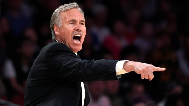 Los Angeles Lakers head coach Mike D'Antoni gestures to his team during the second half of an April 13 game.