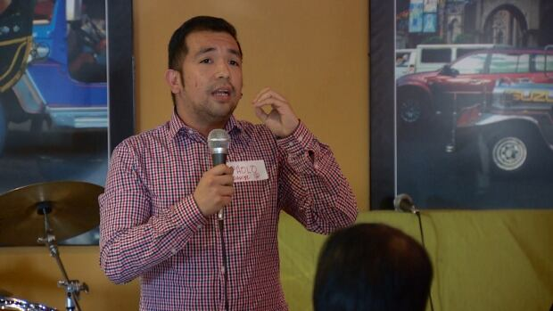 Forum organizer Paolo Oliveros speaks to members of the Filipino community in Calgary about the effects of the Temporary Foreign Worker Program moratorium.