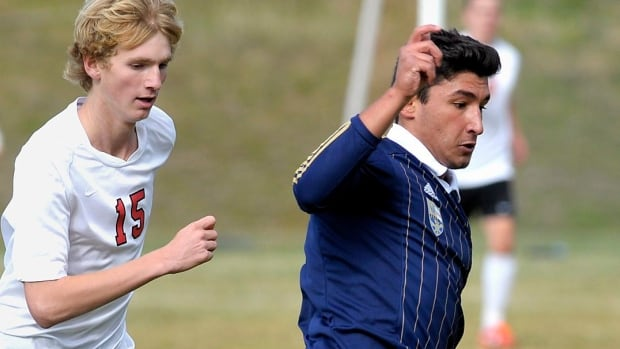 Diren Dede, of Hamburg, Germany, right,  plays in a Big Sky soccer game. Markus Kaarma, a homeowner in Missoula, Montana, on Sunday fired four blasts from a shotgun into his garage, killing Diren Dede who was inside.