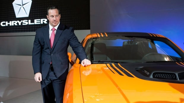 Chrysler Canada's President Reid Bigland poses with the Dodge Challenger Shaker at the Canadian International Auto Show in Toronto on Feb. 13 , 2014. Chrysler Canada's April sales were up 6 per cent.