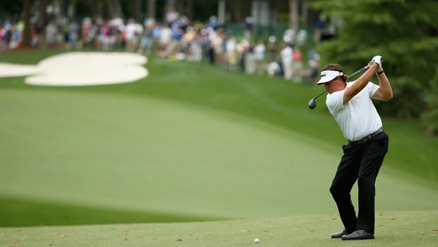 Phil Mickelson hits a fairway wood in the opening round of the Wells Fargo Championship at Quail Hollow Club on Thursday.