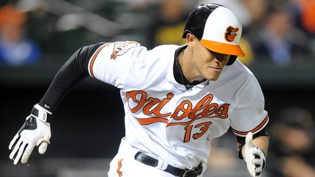 Orioles third  baseman Manny Machado runs to first base after his first at-bat of the season on Thursday. He hadn't played since left knee surgery on Oct. 14.