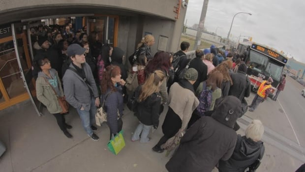 TTC passengers were forced to wait in long lines for shuttle buses after a subway service disruption this morning between Lawrence West and St. George Stations.