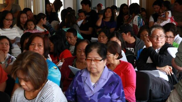 Filipinos gather for the 2013 annual general meeting of the Canadian Filipino Association of the Yukon. Many are worried about their future following the federal government's suspension of the Temporary Foreign Worker program in the fast food sector.