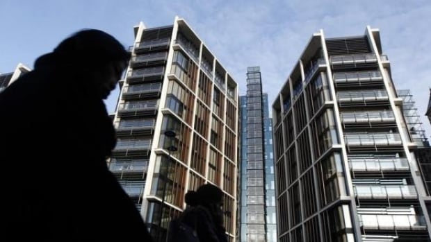 """Pedestrians pass new development One Hyde Park in London in January, 2011. """"We're in boom-time prices, more expensive than we've ever been in the history of mankind,"""" says Nick Candy, one of the developers."""