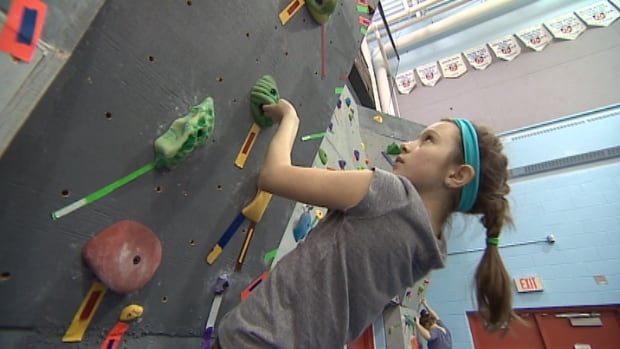 Dasha Barach works her way up the wall in the Rock Divas program.
