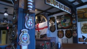 Plaques inside the Crow's Nest Officer's Club