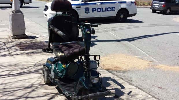 Police said the woman's scooter went right under the wheels of the truck.