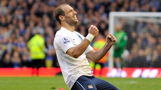 Manchester City's Pablo Zabaleta celebrates their win at the end of their English Premier League soccer match against Everton at Goodison Park in Liverpool.