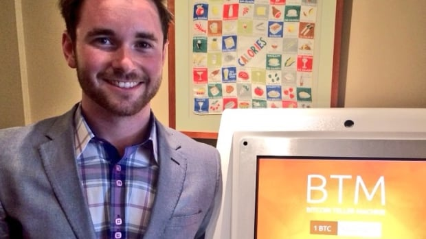 Adam O'Brien poses next to Saskatchewan's first ATM. O'Brien is the founder of Edmonton-based Bitcoin Solutions, a company that plans to open bitcoin ATMs across Canada.