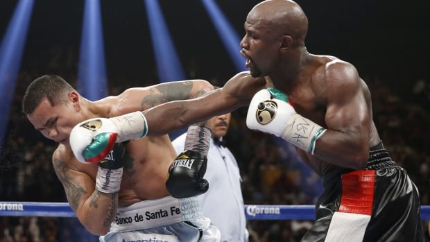 Floyd Mayweather Jr., right, connects with a right to the head of Marcos Maidana at MGM Grand in Las Vegas on Saturday.