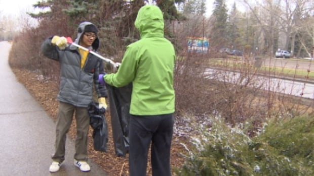 Volunteers braved the cool weather to help pick-up a winter's worth of garbage from the  Edmonton river valley.