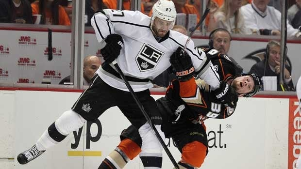Alec Martinez of Los Angeles, left, powers past Anaheim Ducks forward Matt Beleskey in Game 1 at Honda Center.