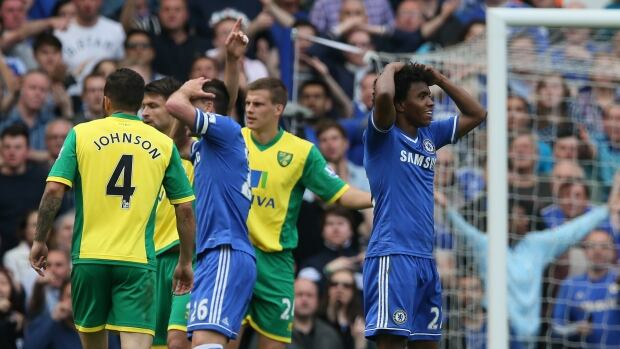 Chelsea's Willian, right, reacts after a foul on his teammate Eden Hazard, by Norwich's Ryan Bennett at Stamford Bridge stadium in London on Sunday.