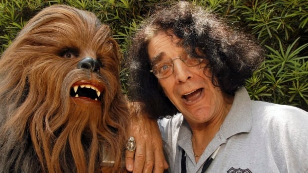 A woman played an anniversary prank on her husband on May 4 by getting people to prank call his phone number with their best Chewbacca impression. Peter Mayhew, right, played Chewbacca in the classic Star Wars series.