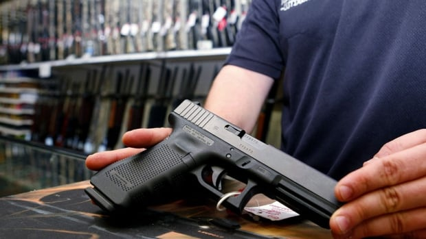 A Glock handgun available in a raffle promotion is shown at Adventures Outdoors in Smyrna, Georgia. Church leaders are opposing a new law in the state that expands gun rights, allowing legal owners to carry firearms into churches and bars.