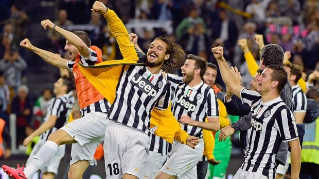 Juventus players celebrate at the end of a 1-0 victory over Atalanta in a Serie A match in Turin. It was Juventus' 18th win in as many home games this season.