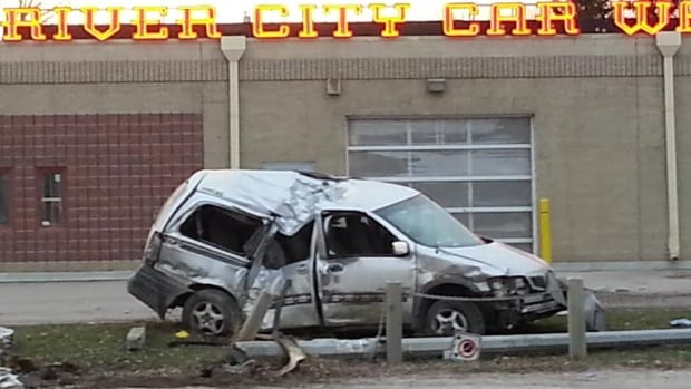 A crumpled minivan sits near River City Car Wash on Osborne Street after a crash early Tuesday.
