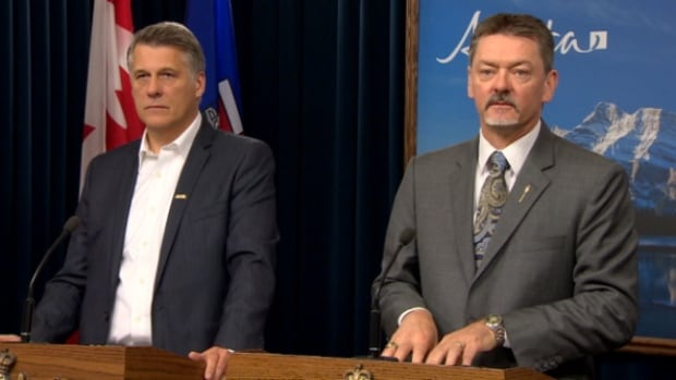 AUPE president Guy Smith (left) joined Finance Minister Doug Horner for Tuesday's announcement.