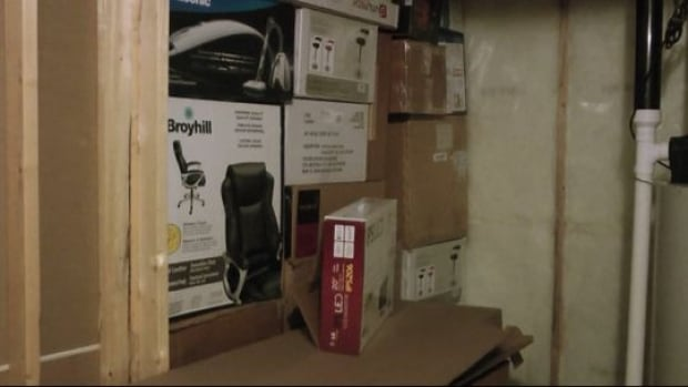 Police raided a home in southeast Calgary, finding a credit card manufacturing operation in a room hidden behind a wall of boxes in the basement.