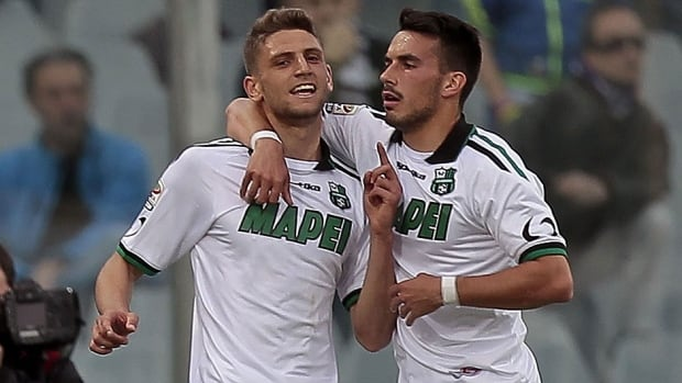 Domenico Berardi, right, of US Sassuolo Calcio celebrates after scoring a goal during a Serie A match against ACF Fiorentina at Stadio Artemio Franchi in Florence on Tuesday. The on-loan Juventus forward scored three times in a 4-3 win, giving Berardi 16 goals in his debut Serie A season.