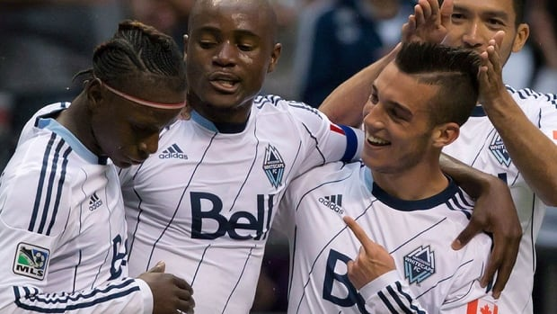 Whitecaps' Russell Teibert, second from right, will start for coach Carl Robinson's squad in Wednesday's first leg of the Amway Canadian Championship semifinal against Toronto FC. The 21-year-old has 46 Major League Soccer appearances under his belt.