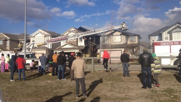 Fire crews are still on scene near 170th Avenue and 76th Street in north Edmonton where a fire started between two homes spread, causing extensive damage to both.