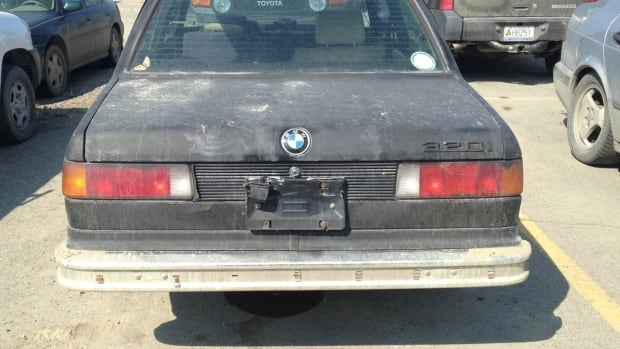 A BMW with no licence plates sits in the parking lot at the Whitehorse airport.