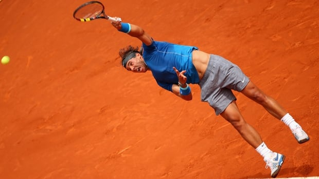 Rafael Nadal unleashes a hard serve in a 6-1, 6-0 victory over Juan Monaco at Caja Magica in Madrid, Spain, on Wednesday.