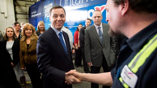 Ontario PC Leader Tim Hudak greets employees of Pacific Western Transportation following a press conference in Mississauga, Ont., on Wednesday.