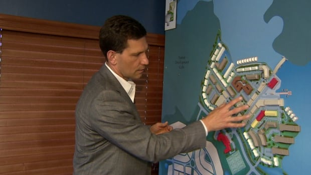 Birol Fisekci, president of Bordeaux Properties, shows off a model of phase 1 of his company's Harmony development, a $6-billion project getting underway this summer in Springbank.